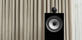 bowers & wilkins 705 S2 in black in front of curtain