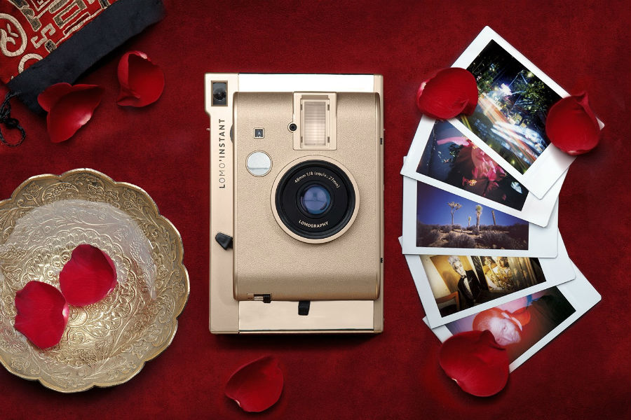 Lomo'Instant Yangon against red cloth with flower petals and photos