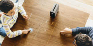 Family playing with Sony Xperia Touch