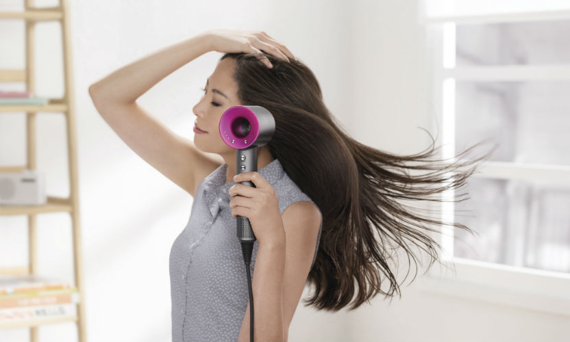 Woman using Dyson Supersonic Hair Dryer