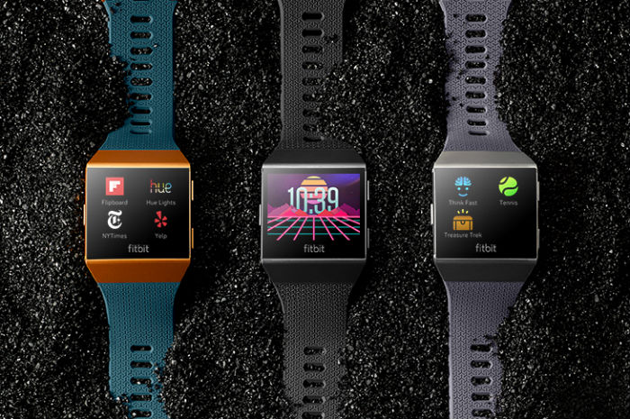 Fitbit Ionic in three colours on gravel