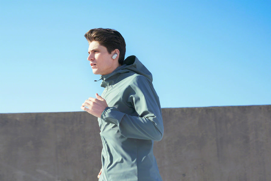 Man running with WF-SP700N earbuds