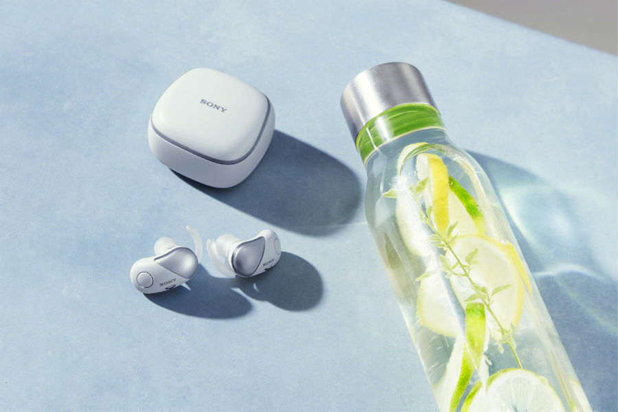 WF-SP700N earbuds next to water bottle