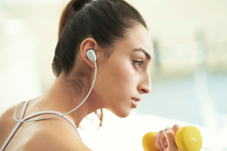 Woman wearing WI-SP600N earbuds