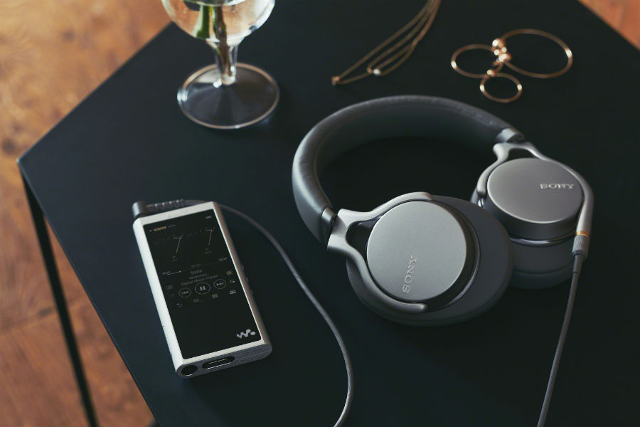 MDR-1AM2 headphones on desk with phone