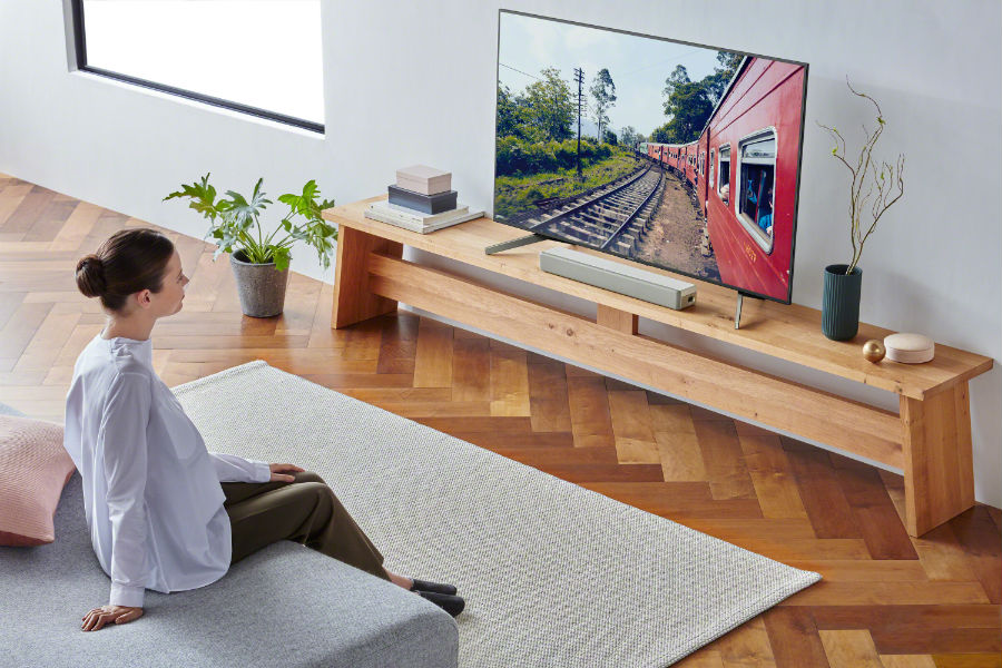 Woman watching TV with Sony HT-S200F