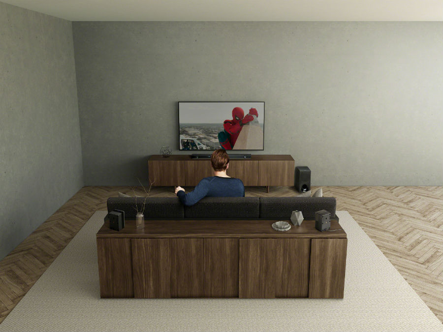 Man watching Spiderman on TV with Sony HT-Z9F