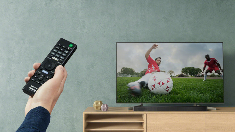 person watching football on tv with Sony HT-X9000F