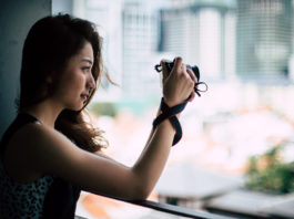 Vanessa holding the Canon M100