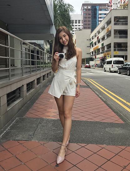 Vanessa posing on a street
