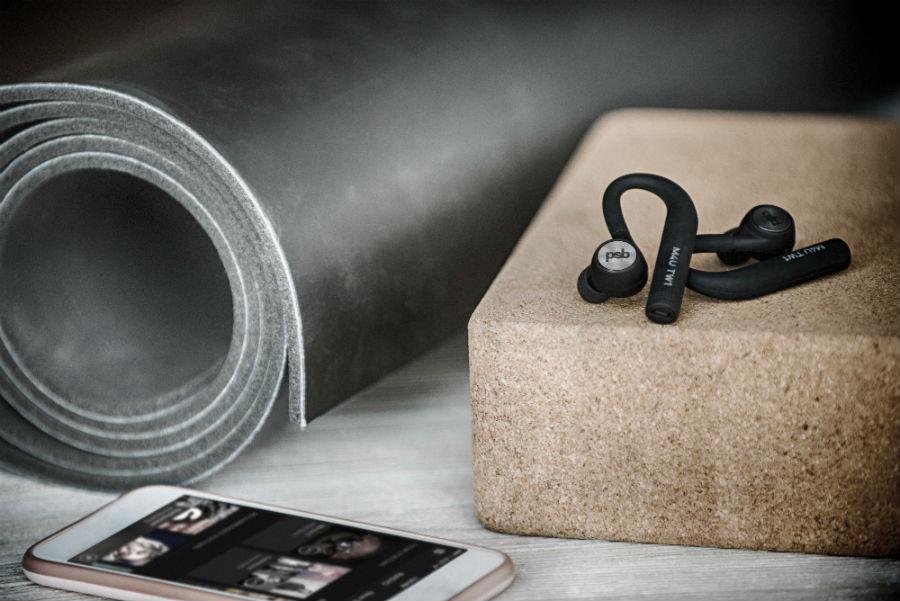 M4U TW1 earphones next to yoga mat