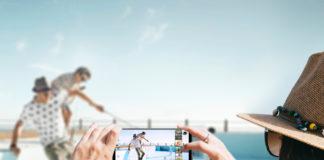 Woman using LG V30+ to take photo