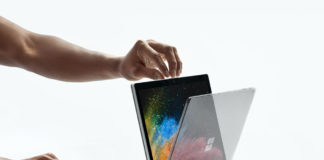 Woman changing Surface Book 2 from laptop to tablet mode