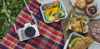 Canon EOS M50 in white on picnic mat
