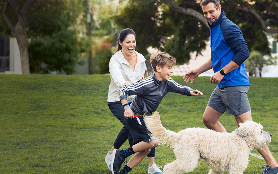 Family playing while wearing Fitbits
