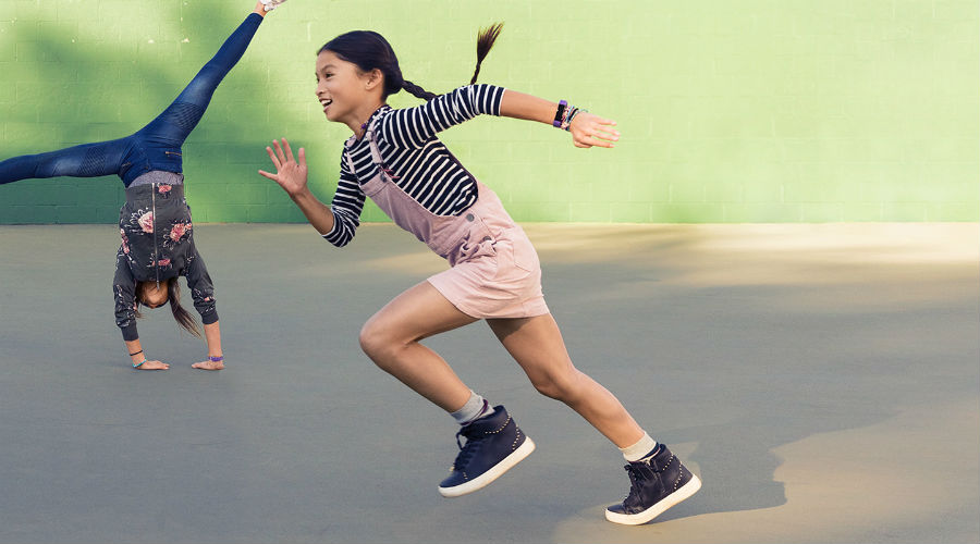 Girls playing while wearing Fitbit Aces
