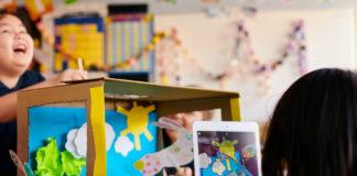 Child using iPad in classroom