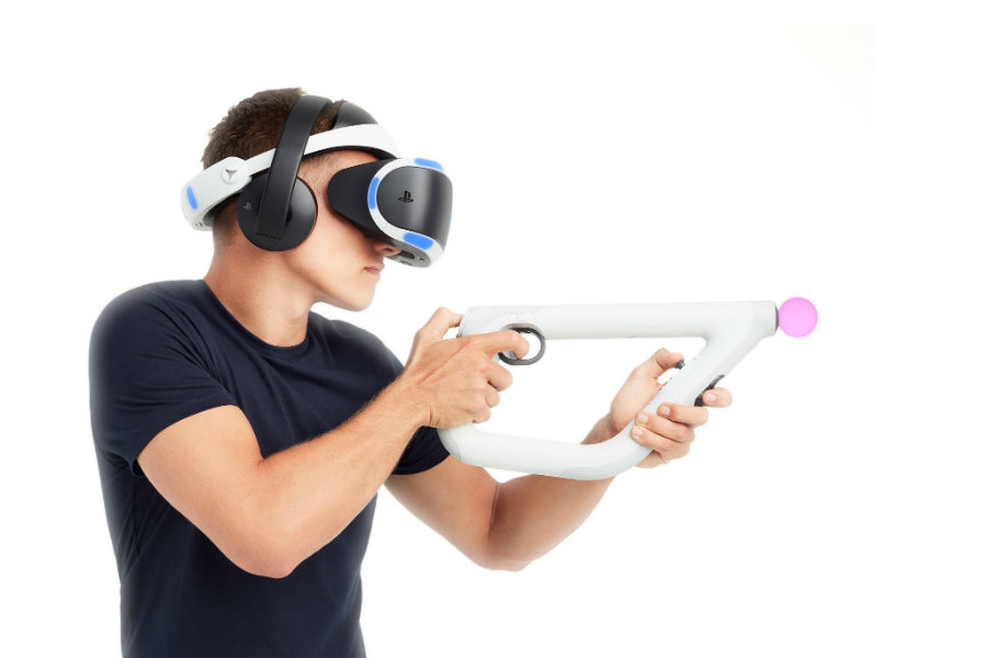 Man using PS VR headset and PS4 wireless headset