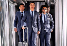Cristiano Ronaldo stepping off a plane in a dapper suit