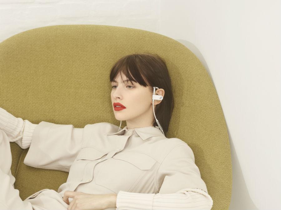 woman wearing B&O Play Earset in white