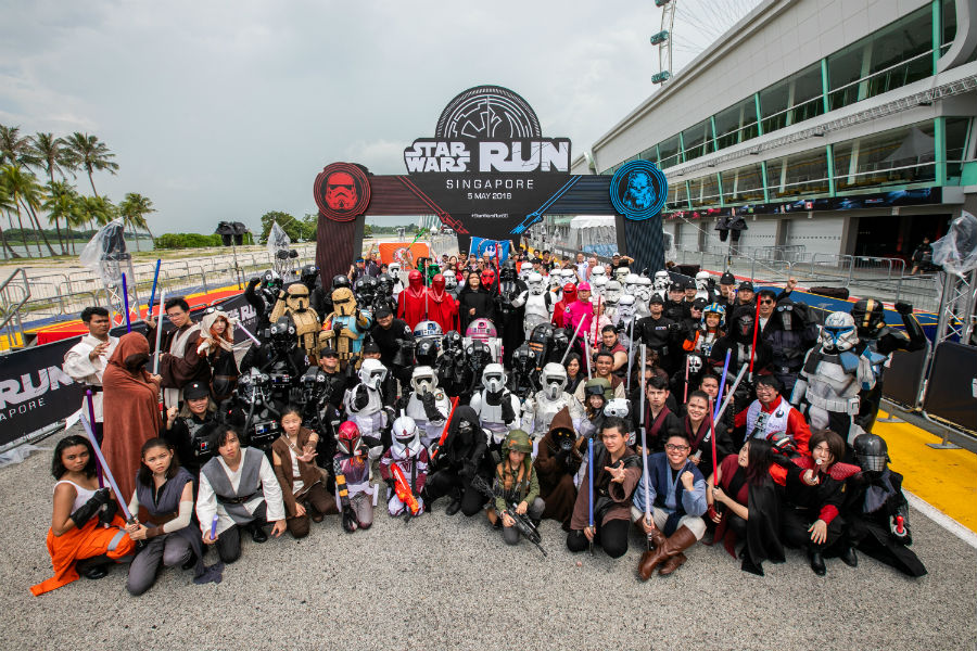 Fans and cosplayers gathered for a group photo