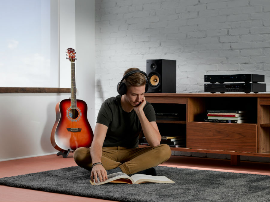 Man listening with VISO HP70 while reading