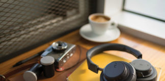 Plantronics BackBeat GO 605 on notebook with camera and coffee in background