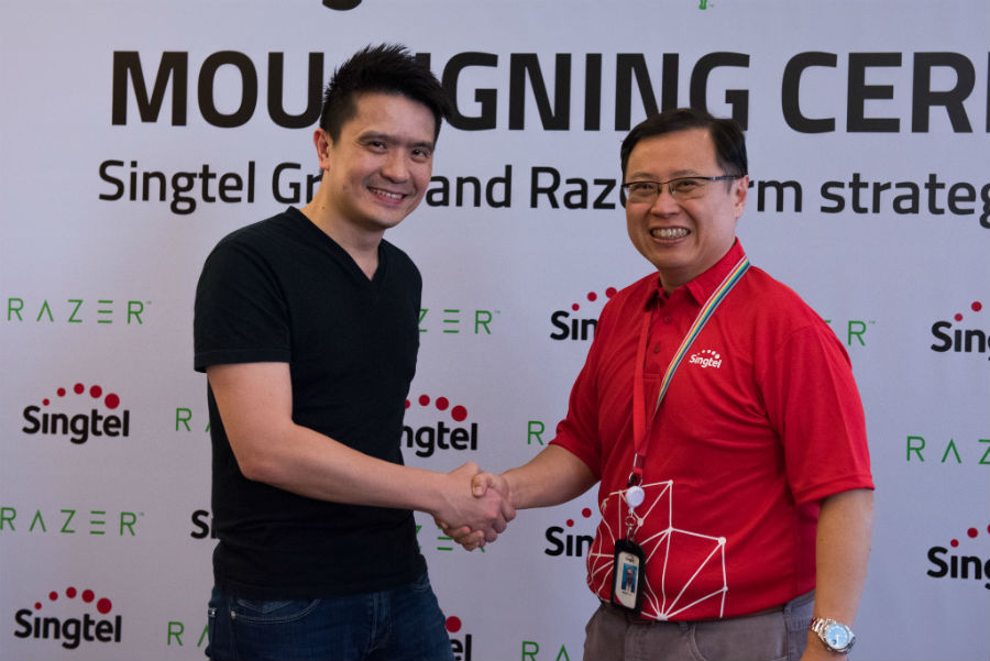 Razer and Singtel representatives shaking hands