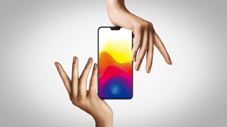 Two hands holding Vivo X21