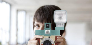 Woman holding the Diana Instant Square