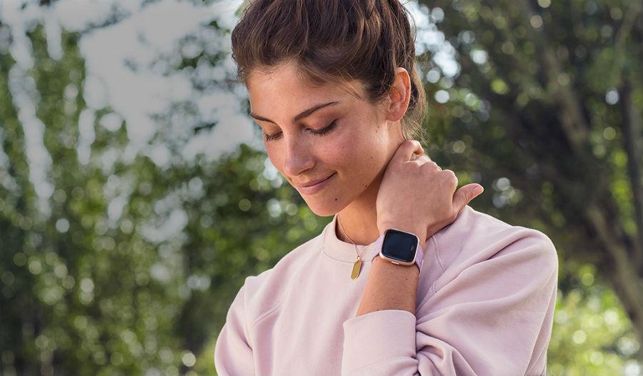 Woman wearing Fitbit Versa