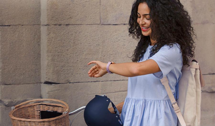 Woman checking Fitbit Versa