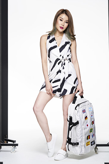 Model with limited edition white CabinZero bag