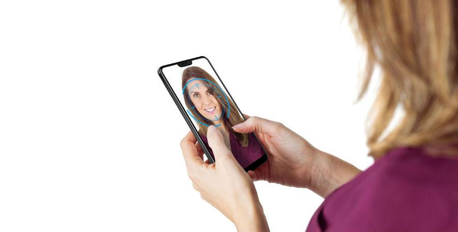 Woman using AI Face Access to unlock Vivo V9