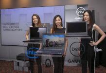 Models presenting Dell gaming laptops
