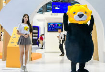 Suning booth with model and mascot at CE China 2018