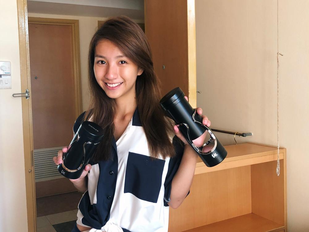 Vanessa holding her Tic Travel Bottle