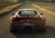Ferrari driving down a road