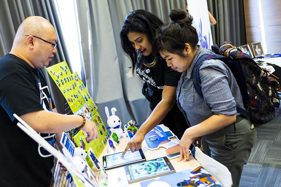 Guests at GameStart Asia 2018 interacting at a showcase