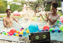 LG XBOOM Go speakers at a pool party