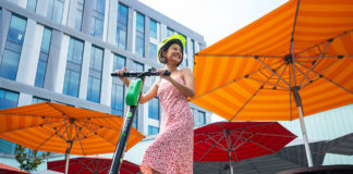 Model on a Lime scooter
