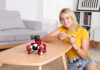 Girl having fun with the GEIO New Generation Gaming Robot