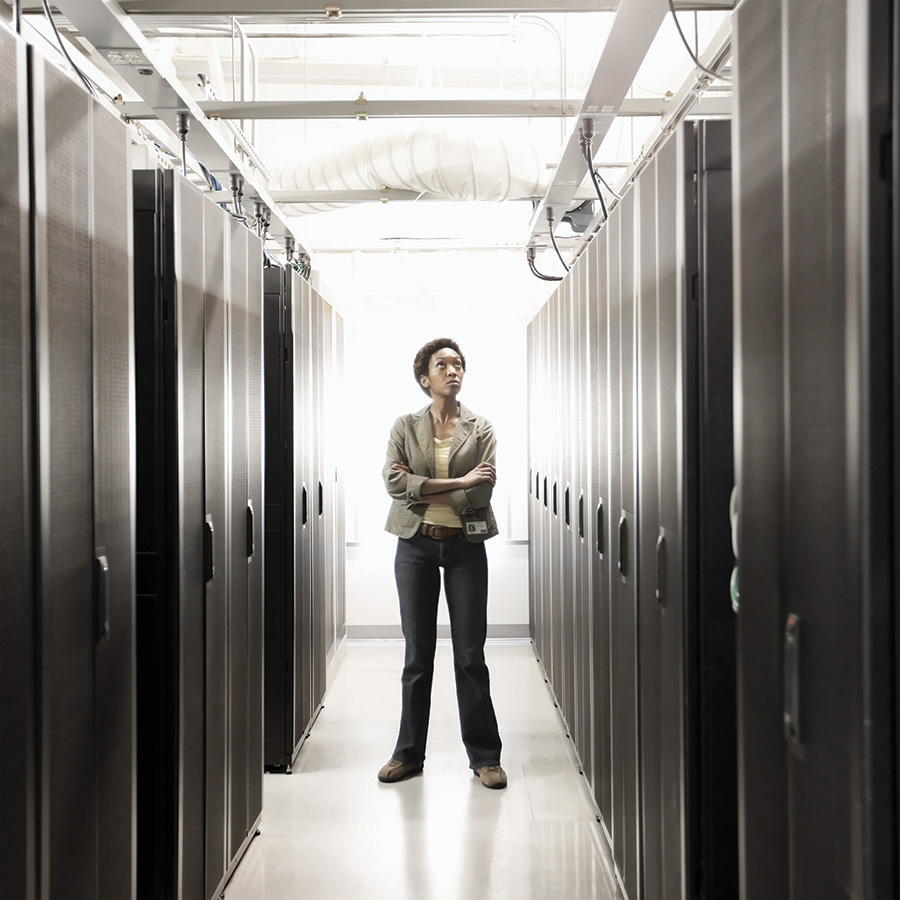 Black businesswoman working in office technology room choosing right server rack