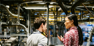 People overseeing a factory, like Microsoft's Azure IoT Connected Factory