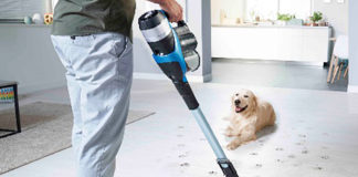 Philips SpeedPro Max Aqua vacuum cleaner with integrated mop being used at home