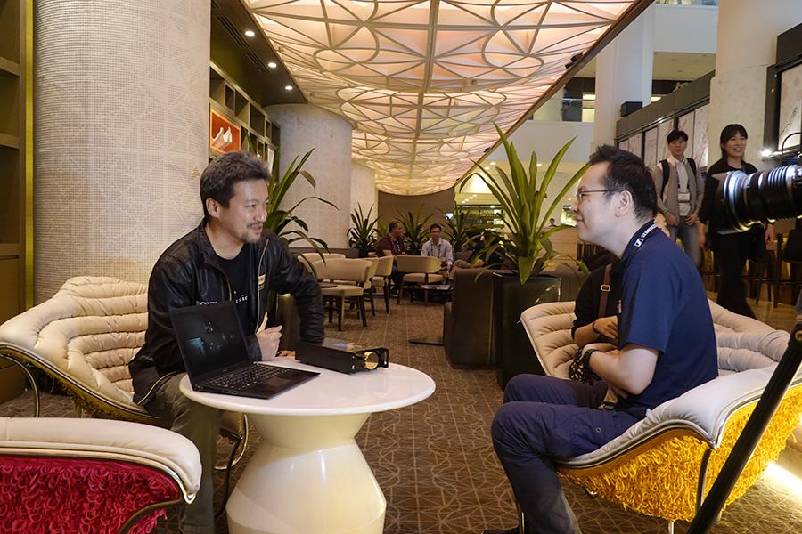 Chester interviewing Tomoaki Sato