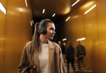 Woman wearing Jabra Elite 85h wireless headphones