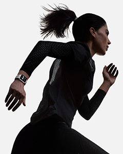 Woman running with Apple Watch Series 3