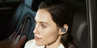 Woman listening to Beoplay E8