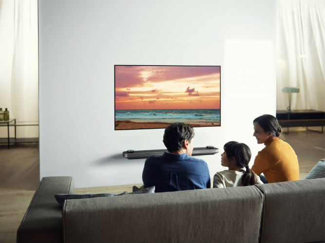 Family watching tv on LG 2017 OLED TV